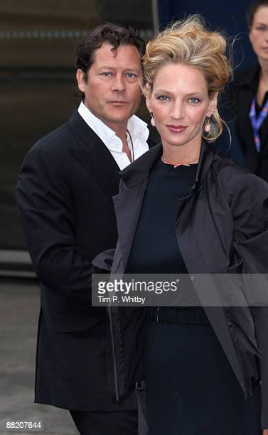 Arpad Busson and Uma Thurman arrive for the ARK Gala Dinner at the disused Waterloo International Terminal on June 4 2009 in London England