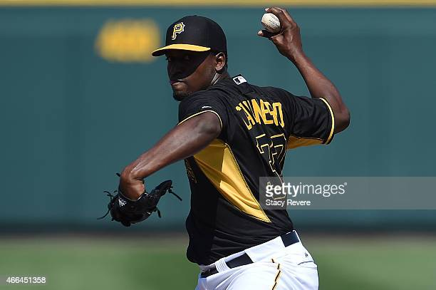 Arquimedes Caminero of the Pittsburgh Pirates throws a pitch during a spring training game against the Baltimore Orioles at McKechnie Field on March...