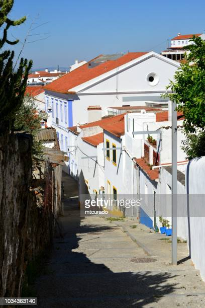 arraiolos - looking down the alley from the castle hill, alentejo, portugal - calçada stock pictures, royalty-free photos & images