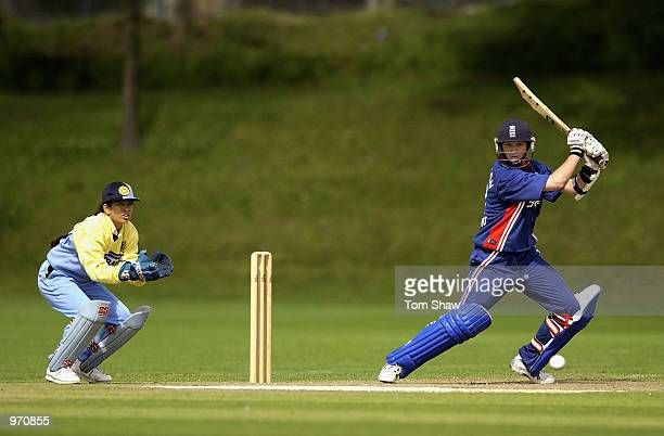 Arran Thompson of England hits out as the Indian Wicketkeeper Sulakshna Naik looks on during the England Womens v Indian Womens One Day International...