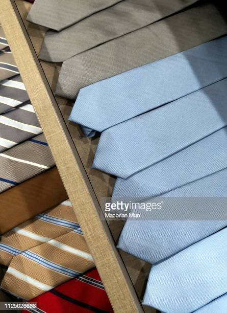 arranged neckties on drawer - tie stock pictures, royalty-free photos & images