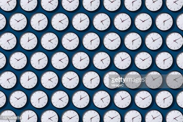arranged timezone clocks on blue - 時間 ストックフォトと画像