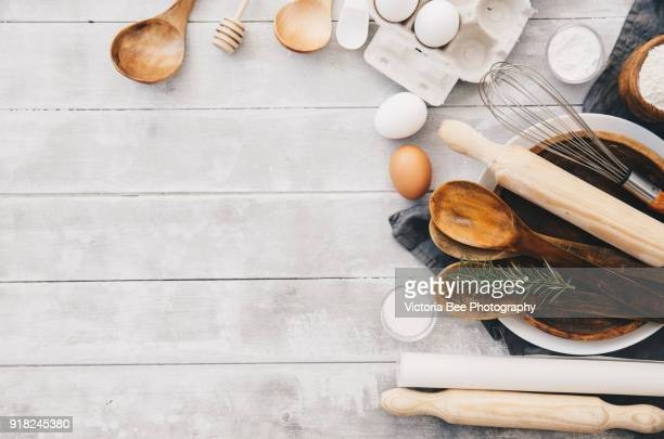 Arrangement of a variety of baking ingredients and utensils. Top view
