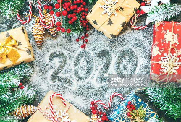 arrangement of christmas ornaments and christmas presents on white background - fake snow stock pictures, royalty-free photos & images