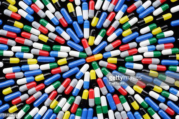 Arrangement of coloured medicine capsules