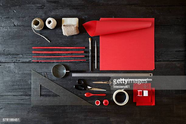 Arrangement of craft materials on black wood