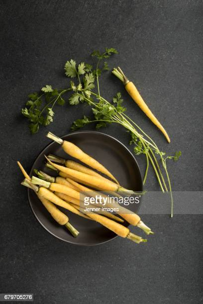 Arrangement of fresh Yellow Carrots.