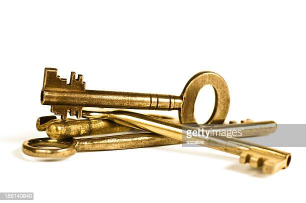 arrangement of old golden safe key - four objects stock pictures, royalty-free photos & images