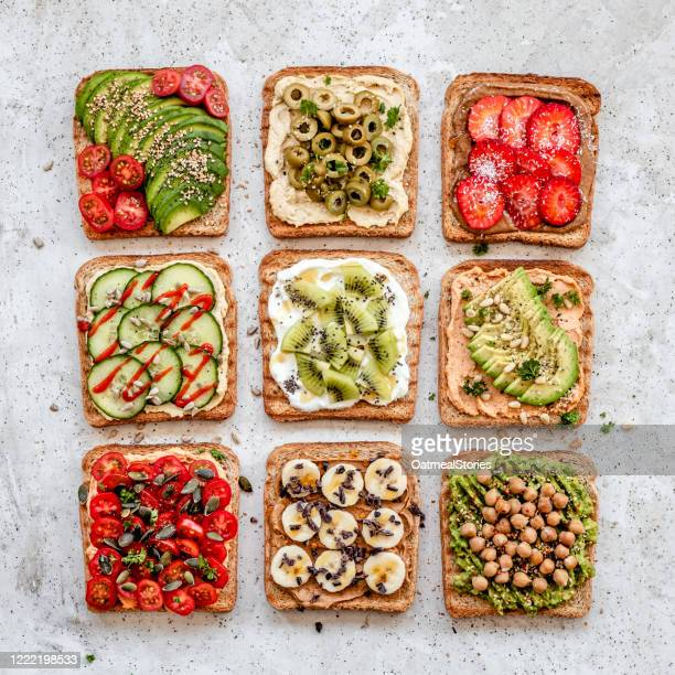 arrangement of savory vegan toasts - toasted bread stock pictures, royalty-free photos & images
