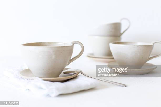 arrangement of tea cups - saucer stock pictures, royalty-free photos & images