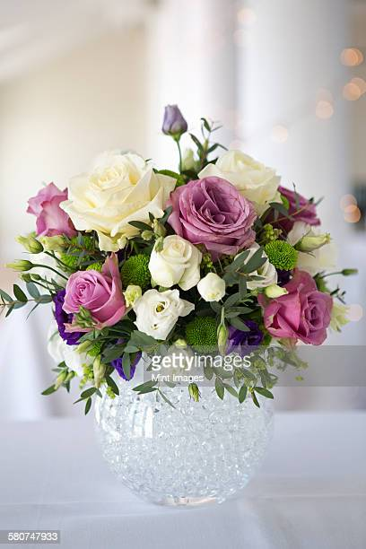 Arrangement of white, pink and purple wedding flowers.