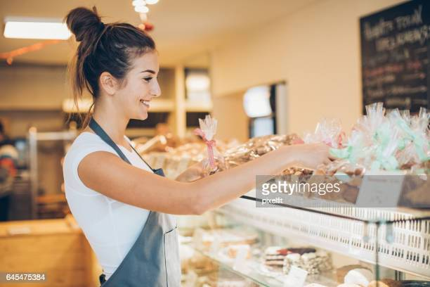 Arranging cookies in the bakery