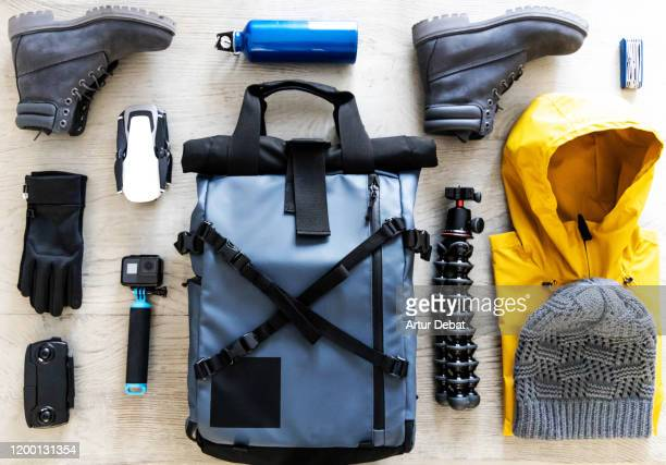 arranging photographic material for outdoor adventure taken from above. - neat video stock pictures, royalty-free photos & images