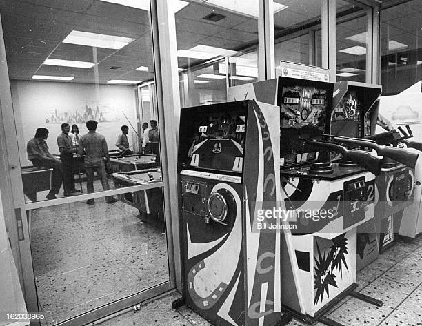JUN 20 1974 JUN 29 1974 JUL 1 1974 Array of coinoperated rifles and machine guns foreground greets persons at Stapleton International Airport Pool...