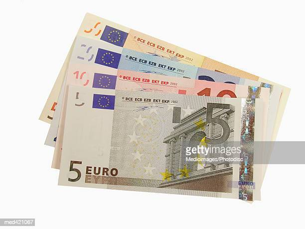 array of euro bank notes - five euro banknote stock photos and pictures