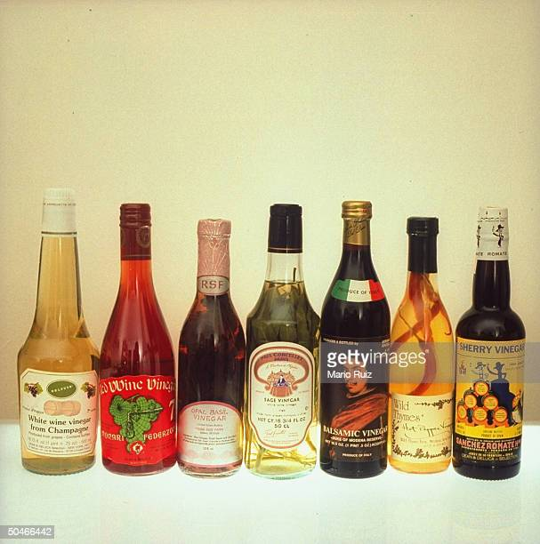 Array of fancy vinegars incl imported red white wine balsamic herbinfused sherry vinegars