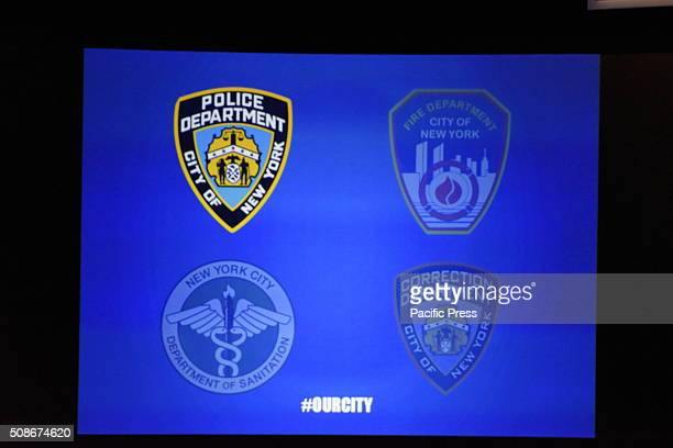 Array of first responder emblems on screen at Lehman College auditorium NYC mayor Bill de Blasio delivered his third state of the city address at...