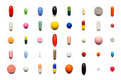 Array of large group of assorted capsules and pills on white background. High resolution image.