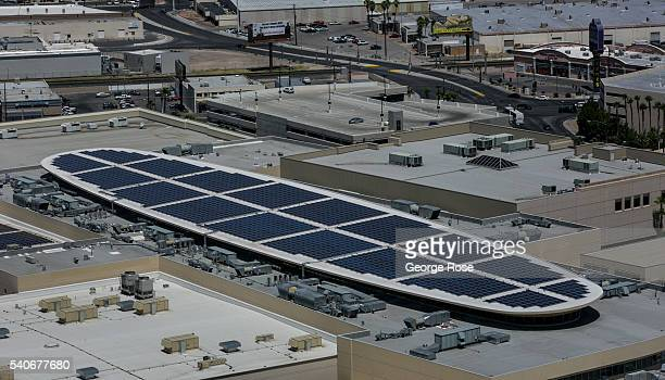 A array of rooftop solar panels on the Fashion Show Shopping Mall is viewed on June 7 2016 in Las Vegas Nevada Tourism in America's 'Sin City' has...