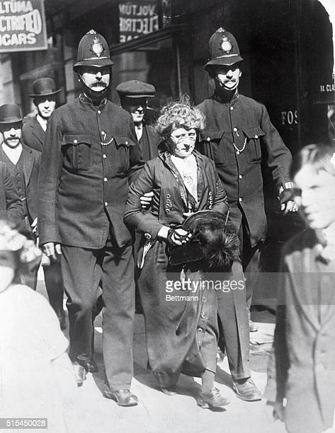 Arrest of a London suffragette by two police bobbies Photograph ca 1905 BPA2# 5477