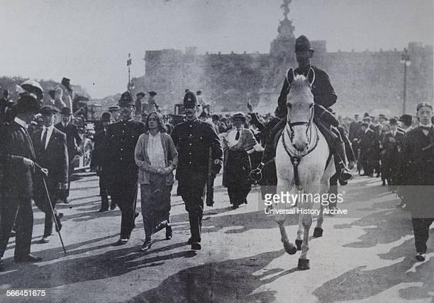 Arrest of Suffragette Dora Thewlis in 1907 outside Buckingham Palace in London