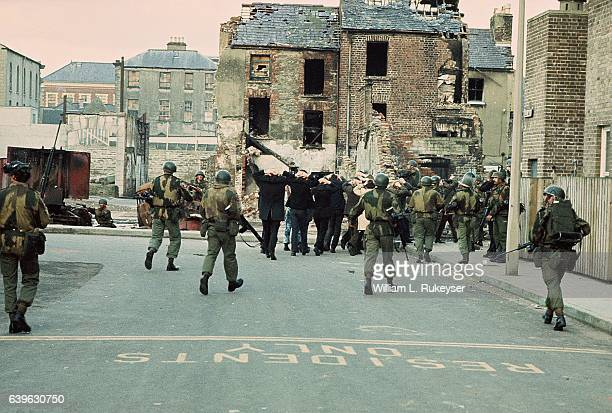 Arrested civilians are marched towards detention in the Bogside Area of Londonderry by British troops on Bloody Sunday 30th January 1972