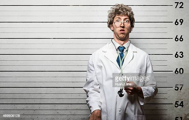 arrested doctor mugshot at police station - medical malpractice stock photos and pictures