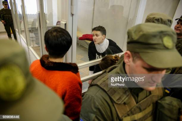 Arrested in accusation of terrorism MP Nadia Savchenko is seen talking to her lawyer from the court cage during the hearing in Kyiv Ukraine March 29...
