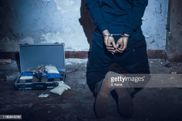 arrested man in handcuffs - terrorism stock pictures, royalty-free photos & images