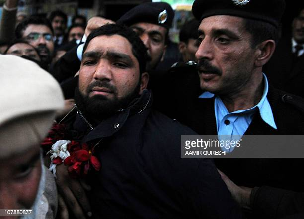 Arrested Pakistani bodyguard Malik Mumtaz Hussain Qadri leaves after appearing in court in Islamabad on January 5 2011 a day after the assassination...