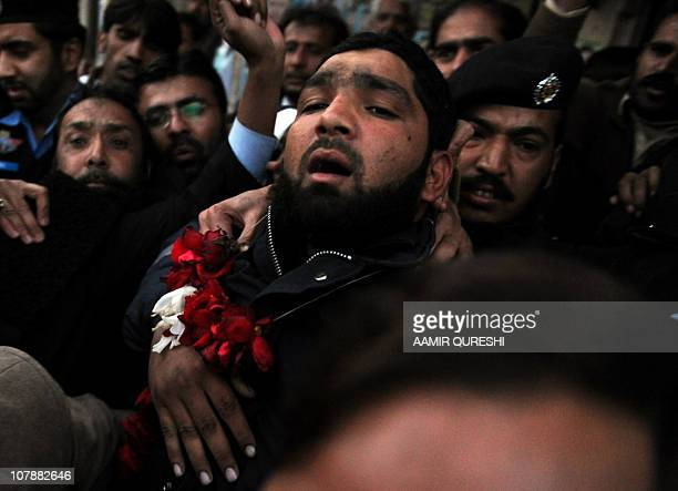 Arrested Pakistani bodyguard Malik Mumtaz Hussain Qadri wearing a garland leaves the court in Islamabad on January 5 2011 a day after the...