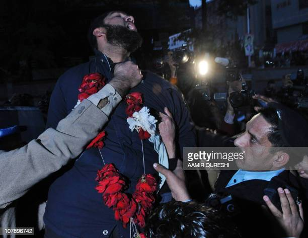 Arrested Pakistani bodyguard Malik Mumtaz Hussain Qadri wearing a garland shouts We are ready to sacrifice our life for the prestige of the Prophet...