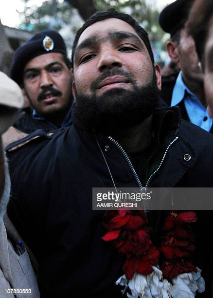 Arrested Pakistani bodyguard Malik Mumtaz Hussain Qadri wearing garland leaves the court in Islamabad on January 5 2011 a day after the assassination...