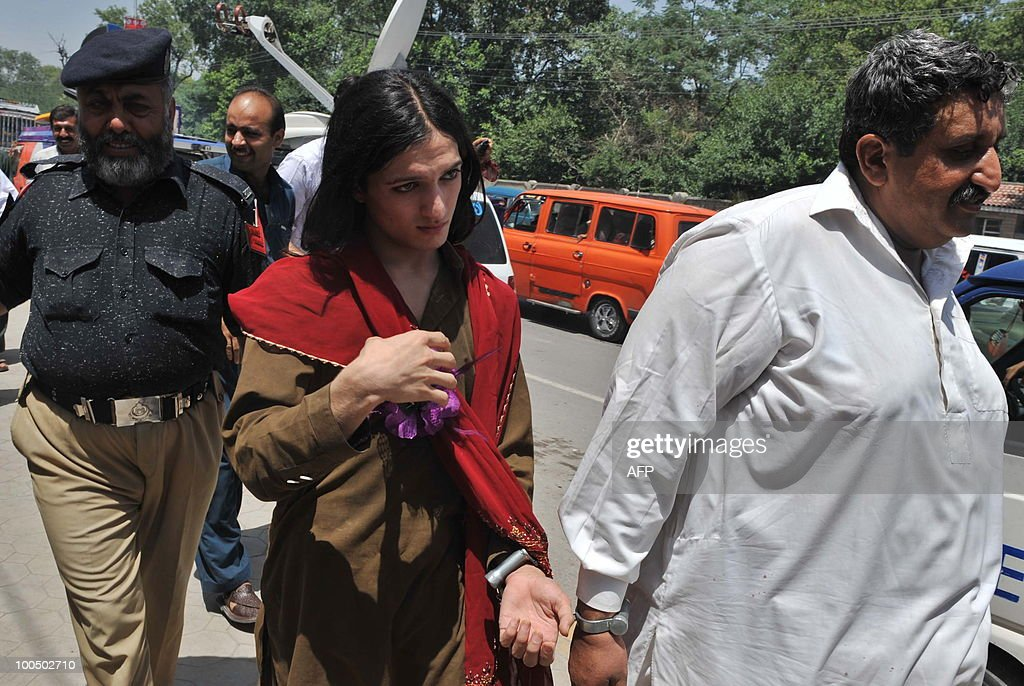 Arrested Pakistani Malik Iqbal (R) and his eunuch partner Kashif (C) leave court in police custody in Peshawar on May 25, 2010. Police arrested Iqbal, for marrying a eunuch in northwestern Pakistan. Under Pakistani law gay marriage or a man�s marriage to a eunuch is a criminal offence and carries a maximum 10-year prison sentence.