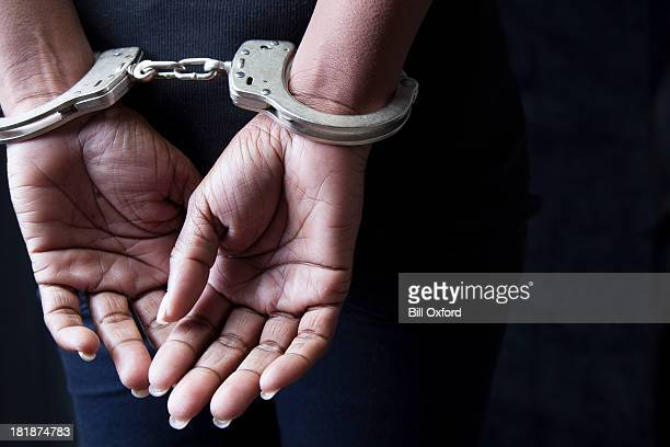 arrested - handcuffs stock pictures, royalty-free photos & images