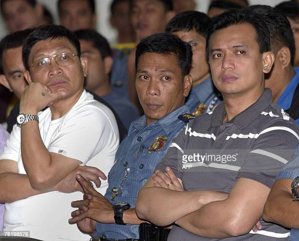 Arrested Senator Antonio Trillanes and army Brigadier General Danilo Lim leaders of a group of renegade soldiers who took over a luxury hotel in the...