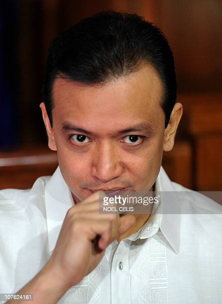 Arrested Senator Antonio Trillanes gestures during a press conference outside a courtroom in Makati Manila's financial district on December 16 2010 A...