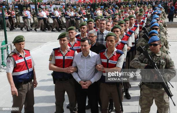 Arrested soldiers accused of being involved in an attempted coup d'etat on 15 July 2016 in Turkey are accompanied by Turkish soldiers as they arrive...