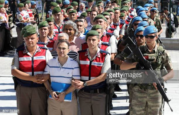 Arrested soldiers who participated in the 2016 attempted coup d'etat are accompanied by Turkish gendarms as they arrive for their trial at Sincan...