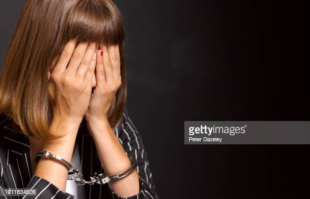 arrested woman woman feeling guilty - arrest stock pictures, royalty-free photos & images