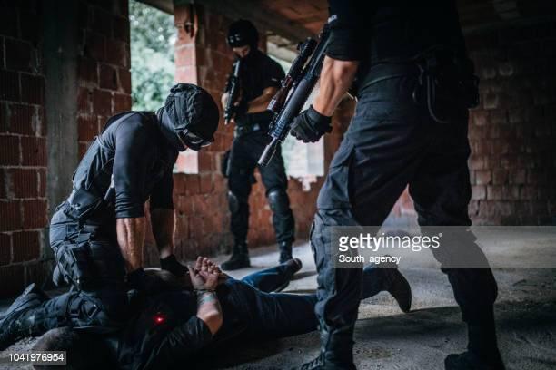 swat arresting a drug dealer - drug trafficking stock pictures, royalty-free photos & images
