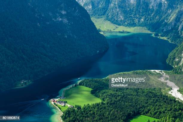 arrial view to lake königssee with st bartholoma church - berchtesgadener land stock photos and pictures