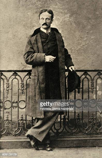 Arrigo Boito , portrait in laying of the writer and librettist and composer, standing, portrayed full figure, near on a balustrade. Photography,...