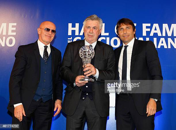 Arrigo Sacchi Real Madrid head coach Carlo Ancelotti and Italy head coach Antonio Conte pose during the Italian Football Federation Hall of Fame...