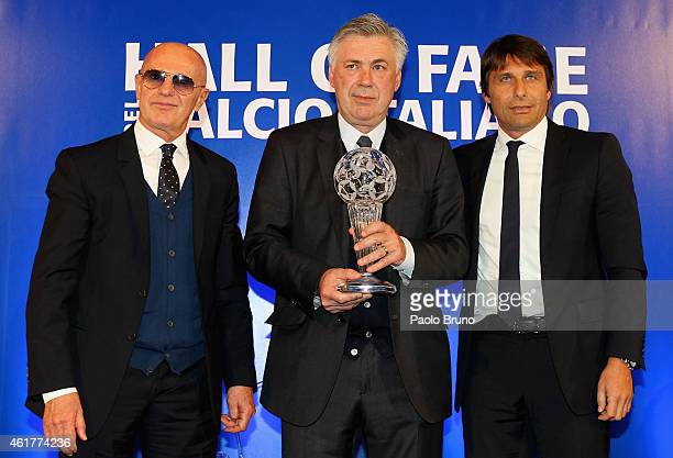 Arrigo Sacchi Real Madrid head coach Carlo Ancelotti and Italy head coach Antonio Conte pose during the Italian Football Federation Hall of Fame...