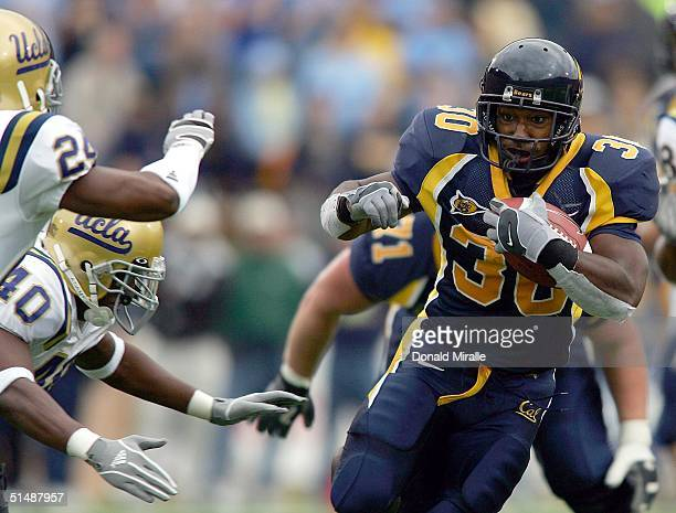 J Arrington of the California Golden Bears runs against the defense of the UCLA Bruins during the 1st half of their Pac10 game at Memorial Stadium on...