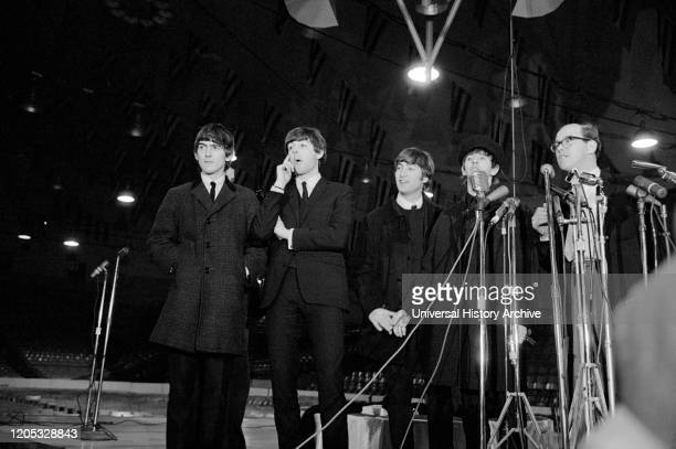Arrival and Press Conference of the British Rock and Roll Band The Beatles, Washington, D.C., USA, photograph by Marion S. Trikosko, February 11,...