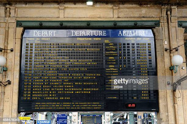 arrival departure board at gare du nord paris france - gare du nord stock pictures, royalty-free photos & images