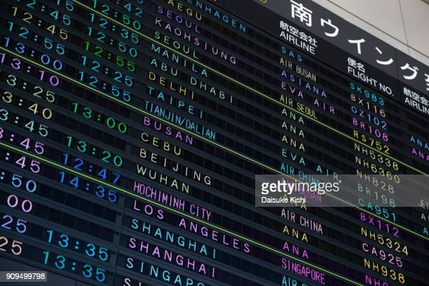 arrival departure board in narita airport, japan - narita international airport stock photos and pictures