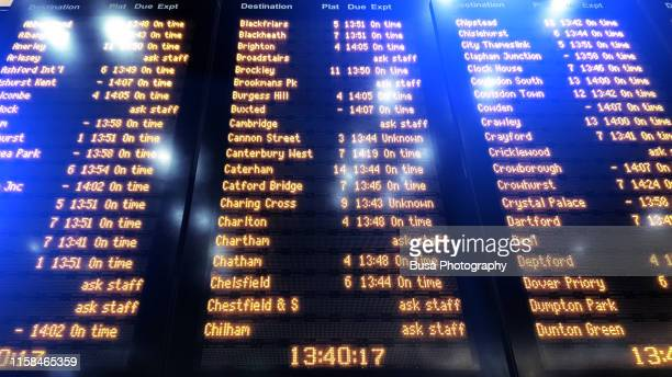 arrival / departure timetable inside the london bridge railway station in london, uk - waiting stock pictures, royalty-free photos & images